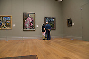 tourists in the El Greco room at the Met in NYC