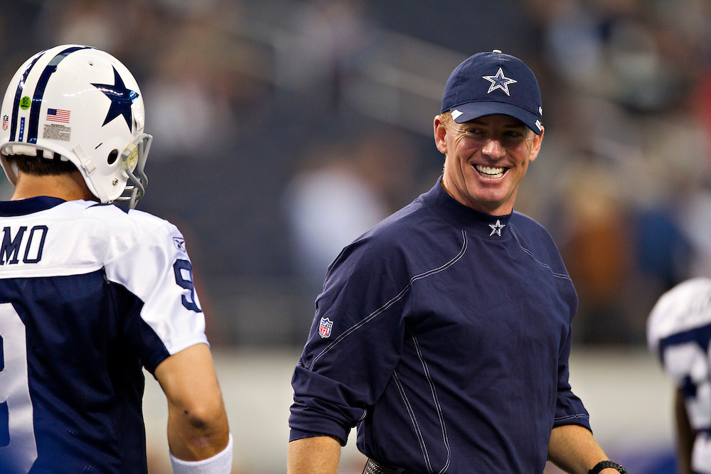 ARLINGTON, TX - NOVEMBER 24:   Head Coach Jason Garrett and quarterback Tony Romo #9 of the Dallas Cowboys talk before a game against the Miami Dolphins at Cowboys Stadium on November 24, 2011 in Arlington, Texas.  The Cowboys defeated the Dolphins  20 to 19.  (Photo by Wesley Hitt/Getty Images) *** Local Caption *** Jason Garrett; Tony Romo
