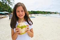 girl child holding drinking coconut, Koh Samet, Thaialnd