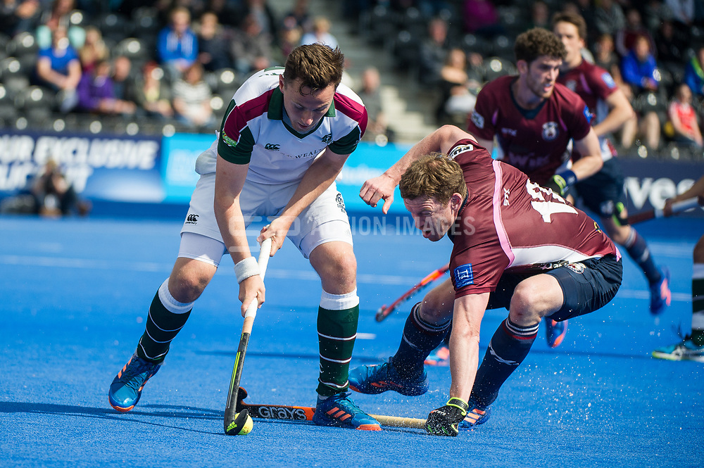 Surbiton's Alan Forsyth is tackled by Mikey Hoare of Wimbledon. Wimbledon v Surbiton - Men's Hockey League Final, Lee Valley Hockey & Tennis Centre, London, UK on 23 April 2017. Photo: Simon Parker