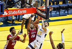 Nov 28, 2018; Morgantown, WV, USA; West Virginia Mountaineers forward Esa Ahmad (23) shoots the ball under the basket during the first half against the Rider Broncs at WVU Coliseum. Mandatory Credit: Ben Queen-USA TODAY Sports