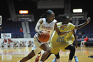 "Ole Miss guard Kiara Golden (00) vs. Southern University Jaguars guard Keonia Parrish (20) at the C.M. ""Tad"" Smith Coliseum in Oxford, Miss. on Thursday, November 20, 2014. (AP Photo/Oxford Eagle, Bruce Newman)"