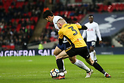 Dan Butler of Newport County tries to tackle Son Heung-Min of Tottenham Hotspur during the The FA Cup fourth round replay match between Tottenham Hotspur and Newport County at Wembley Stadium, London, England on 6 February 2018. Picture by Toyin Oshodi.