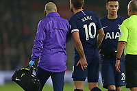 Football - 2019 / 2020 Premier League - Southampton vs. Tottenham Hotspur<br /> <br /> Harry Kane of Tottenham clutches his hamstring as he limps off during the Premier League match at St Mary's Stadium Southampton <br /> <br /> COLORSPORT/SHAUN BOGGUST