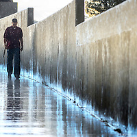 091313  Adron Gardner/Independent<br /> <br /> David Gibbons is pelted with rain as he walks down the football field in Ramah Friday.
