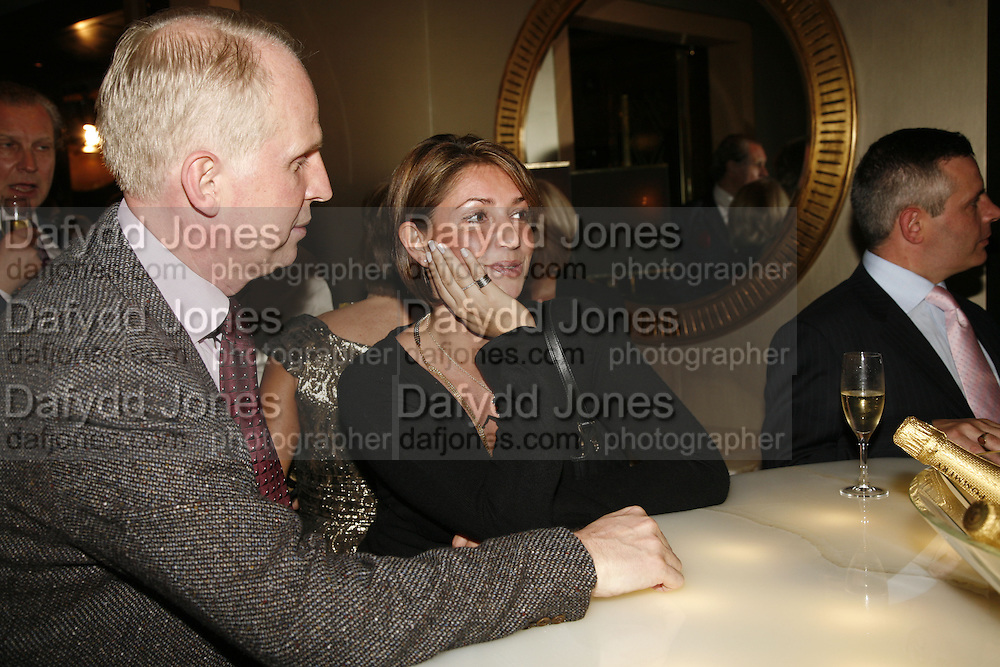 Joe P and Zoki Kuzmancevic, The launch of Gilt, a new champagne lounge in the Jumeira Carlton Tower Hotel. Sloane st. London. 17 October 2006. -DO NOT ARCHIVE-© Copyright Photograph by Dafydd Jones 66 Stockwell Park Rd. London SW9 0DA Tel 020 7733 0108 www.dafjones.com