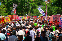A large crowd wanders past the food stalls at Nakajima Park in Sapporo, Hokkaido, Japan. They are there for the annual Sapporo Matsuri festival.