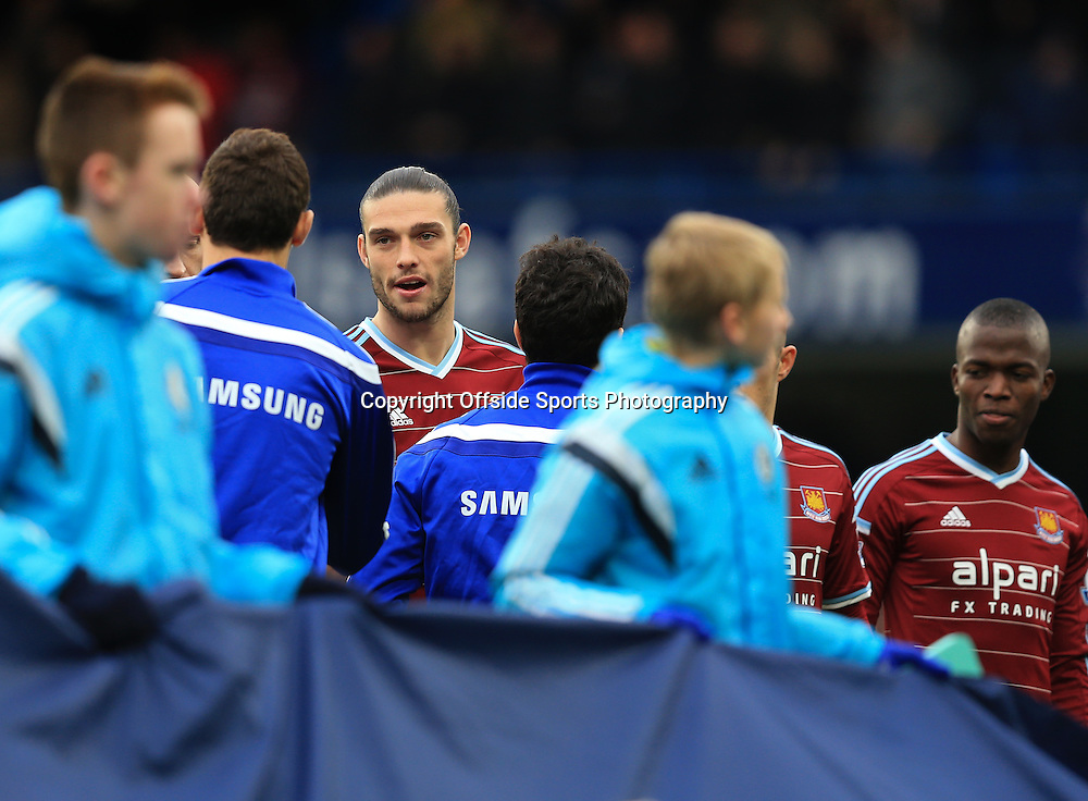 26 December 2014 - Barclays Premier League - Chelsea v West Ham - Andy Carroll of West Ham shakes hands with Nemanja Matic and Cesc Fabregas of Chelsea - Photo: Marc Atkins / Offside.