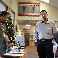 Technology Trainer Markos Chavez, left, and Informaiton Specialist Adrian Vickerz host a Gadget Garage Workshop at Octavia Fellin Library in Gallup Tuesday. The library purchases various laptops and reading tablets for people to handle and learn.
