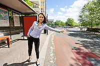 Full length beautiful businesswoman hailing taxi on street