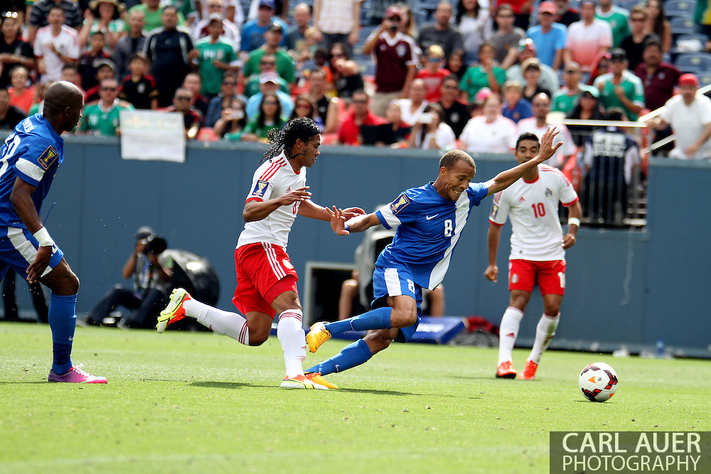 July 14 2013:  Martinique Defender Audrick Linord (8) out runs Mexico Midfield Carlos Peña (6) during the first half of the CONCACAF Gold Cup soccer match between Martinique and Mexico at Sports Authority Field in Denver, CO. USA.