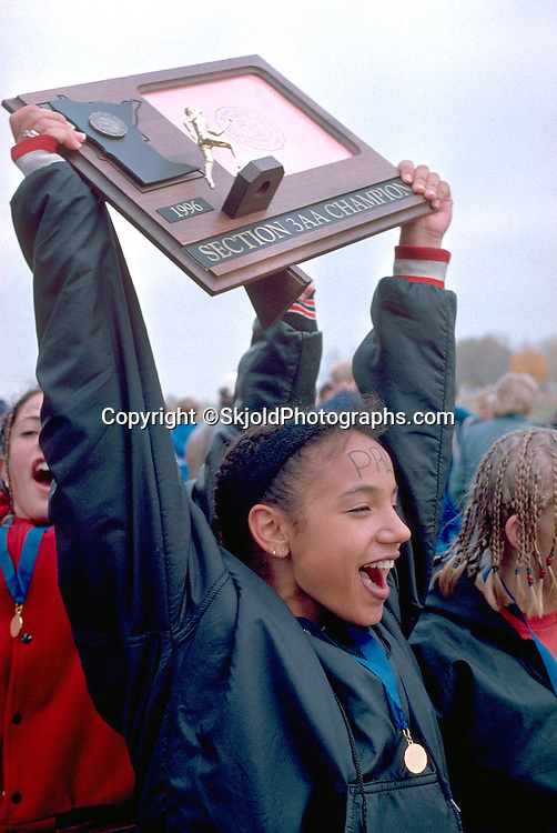 Cross country champion age 17 celebrating win at regional race. Park Reserve Spring Lake Hastings  Minnesota USA