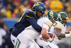 Dec 3, 2016; Morgantown, WV, USA; West Virginia Mountaineers defensive lineman Adam Shuler (88) sacks Baylor Bears quarterback Zach Smith (4) during the first quarter at Milan Puskar Stadium. Mandatory Credit: Ben Queen-USA TODAY Sports