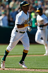 OAKLAND, CA - JULY 28:  Khris Davis #2 of the Oakland Athletics runs to first base after drawing a game ending RBI walk during the ninth inning at the RingCentral Coliseum on July 28, 2019 in Oakland, California. The Oakland Athletics defeated the Texas Rangers 6-5. (Photo by Jason O. Watson/Getty Images) *** Local Caption *** Khris Davis