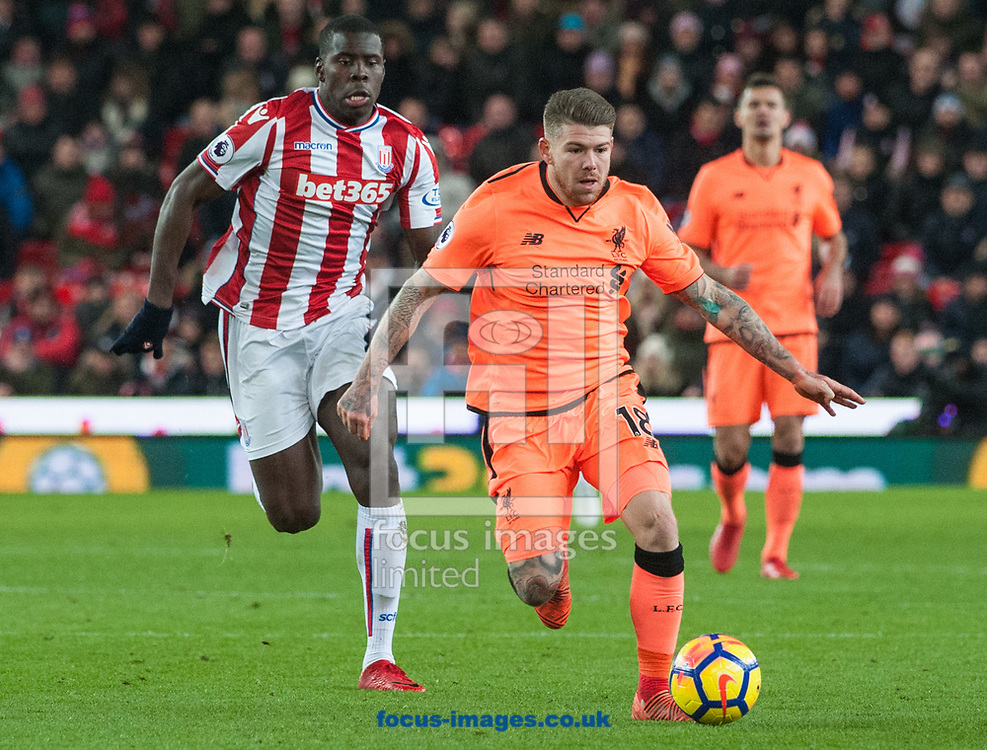 Alberto Moreno of Liverpool pushes forward ahead of Bruno Martins Indi of Stoke City during the Premier League match at the Bet 365 Stadium, Stoke-on-Trent<br /> Picture by Matt Wilkinson/Focus Images Ltd 07814 960751<br /> 29/11/2017