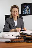 12 DEC 2005, BERLIN/GERMANY:<br /> Ursula von der Leyen, CDU, Bundesfamilienministerin, an ihrem Schreibtisch, in ihrem Buero, Bundesministerium fuer Familie, Senioren, Frauen, und Jugend<br /> Ursula von der Leyen, Federal Minister for family, Seniors, Women and Youth, in her office<br /> IMAGE: 20051212-01-007<br /> KEYWORDS: Büro