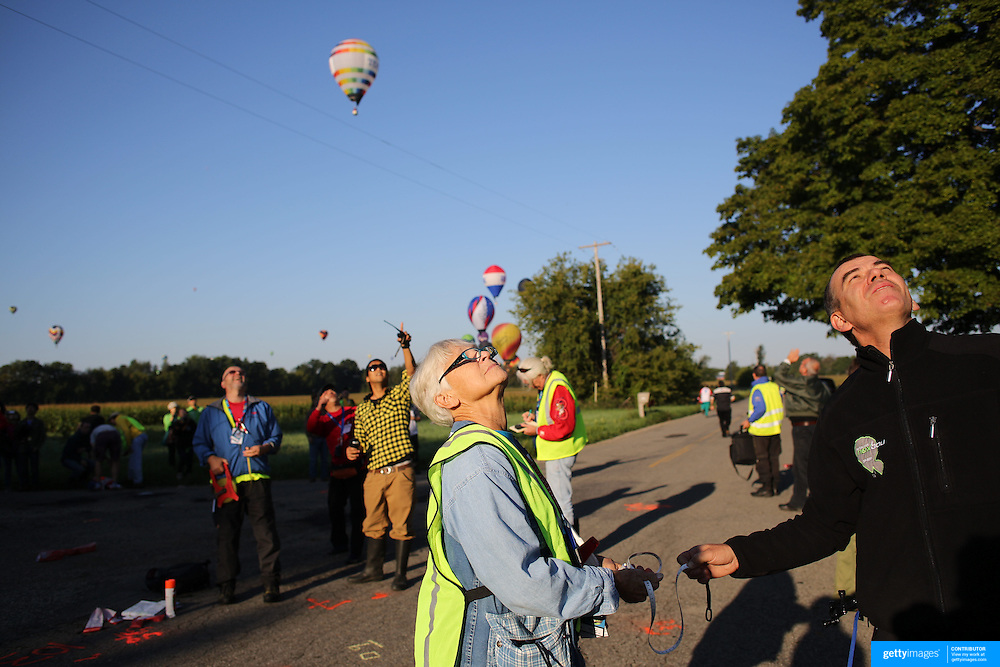 Hot Air balloons are guided by support crew members to drop markers at a goal location around rural Michigan near Battle Creek during the World Hot Air Ballooning Championships. Battle Creek, Michigan, USA. 21st August 2012. Photo Tim Clayton
