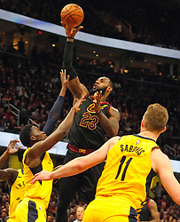 April 25, 2018 - Cleveland, OH, USA - The Cleveland Cavaliers' LeBron James (23) scores over the Indiana Pacers' Victor Oladipo and Domantas Sabonis (11) during the third quarter in Game 5 on Wednesday, April 25, 2018, at Quicken Loans Arena in Cleveland. The Cleveland Cavaliers won, 98-95, for a 3-2 lead in the first-round NBA playoff series. (Credit Image: © Leah Klafczynski/TNS via ZUMA Wire)