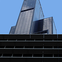 Chicago's Willis Tower looms above another building under construction in Chicago, Illinois in 2013.