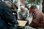 Men playing checkers  in Old Shanghai, China