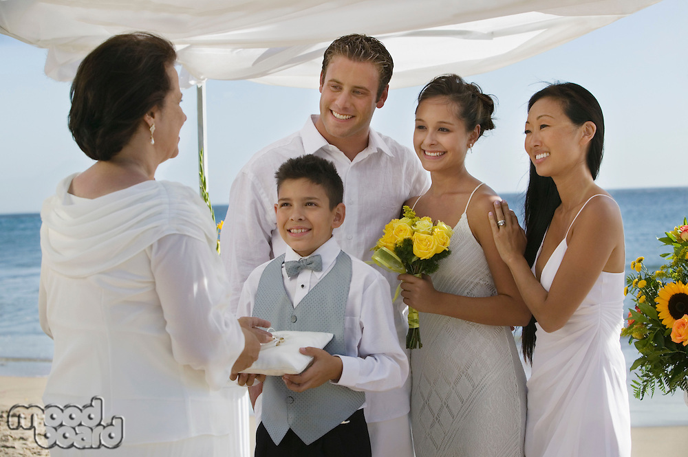 Bride and Groom on Beach With Family
