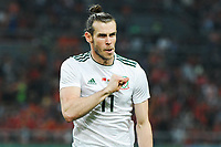 Gareth Bale of Wales national football team celebrates after scoring against Chinese national men's football team in the semi-final match during the 2018 Gree China Cup International Football Championship in Nanning city, south China's Guangxi Zhuang Autonomous Region, 22 March 2018.