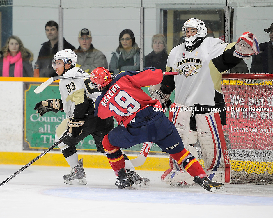 TRENTON, ON - Feb 27, 2015 : Ontario Junior Hockey League game action between the Trenton Golden Hawks and the Wellington Dukes. Game one of the best of seven series, Braden Hellems #93, Justin Kapelmaster #33 of the Trenton Golden Hawks and Joe Mckeown #19 of the Wellington Dukes during the second period<br /> (Photo by Amy Deroche/ OJHL Images)