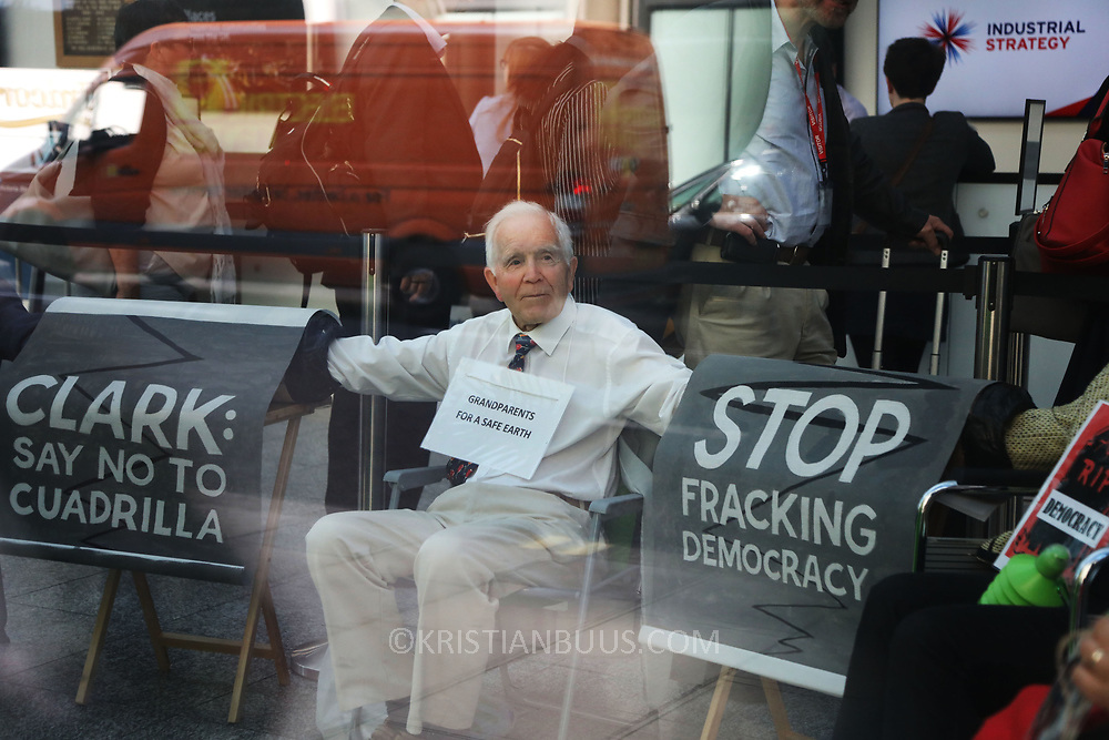 A group of grandparents and elders have chained themselves together in a government department building in Westminster to urge the government to oppose &ldquo;dangerous&rdquo; fracking June 13th 2018, Central London, United Kingdom.<br /> Philip Kingston, 80. &quot; It is so important the government takes climate change seriously and they are not doing it&quot;.<br /> <br /> Aged between 63 and 82, the 10-strong group from the South West - Grandparents for a Safe Earth (GFASE) - have occupied the Westminster building to demand that the Secretary of State for the Department for Business, Energy and Industrial Strategy Greg Clark refuse permission for fracking.