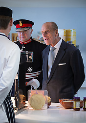 © Licensed to London News Pictures . 14/11/2013 . Manchester , UK . Prince Philip the Duke of Edinburgh checks out some of the food in the canteen . Queen Elizabeth II and the Duke of Edinburgh visit the Coop building at 1 Angel Square , Manchester , this morning ( 14th November 2013 ) . Photo credit : Joel Goodman/LNP