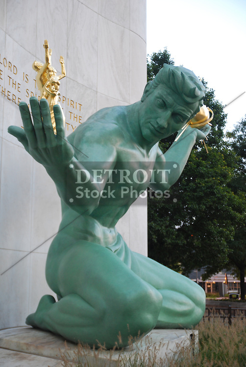 The Spirit of Detroit is a city monument with a large bronze statue created by Marshall Fredericks and located at the Coleman A. Young Municipal Center on Woodward Avenue in Detroit, Michigan, USA. It was commissioned in 1955 for a cost of $58,000, and dedicated in 1958. In its left hand, the large seated figure holds a gilt bronze sphere emanating rays to symbolize God. In its right hand, is a family group symbolizing all human relationships. The 26-foot (7.9 m) sculpture was the largest cast bronze statue since the Renaissance when it was first installed.