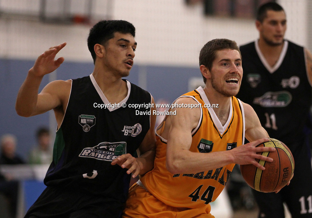 Rangers' Shea Ili challenges Taranaki's Jack Leasure in an NBL Basketball Match, Super City Rangers v Taranaki Mountain Airs, Otara, Auckland, New Zealand, Sunday, May 05, 2013. Photo: David Rowland/Photosport