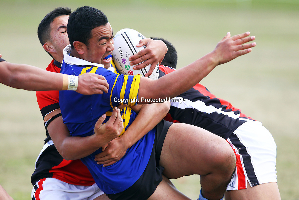 Wayne Afoa is tackled, New Zealand Secondary Schools National Rugby League Tournament, Otahuhu College v Papatoetoe High School. Bruce Pulman Park, Auckland. 4 September 2012. Photo: William Booth/photosport.co.nz