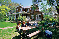 Family enjoying snacks on lawn table, Sunflower Hill Bed & Breakfast Inn Moab, UTAH