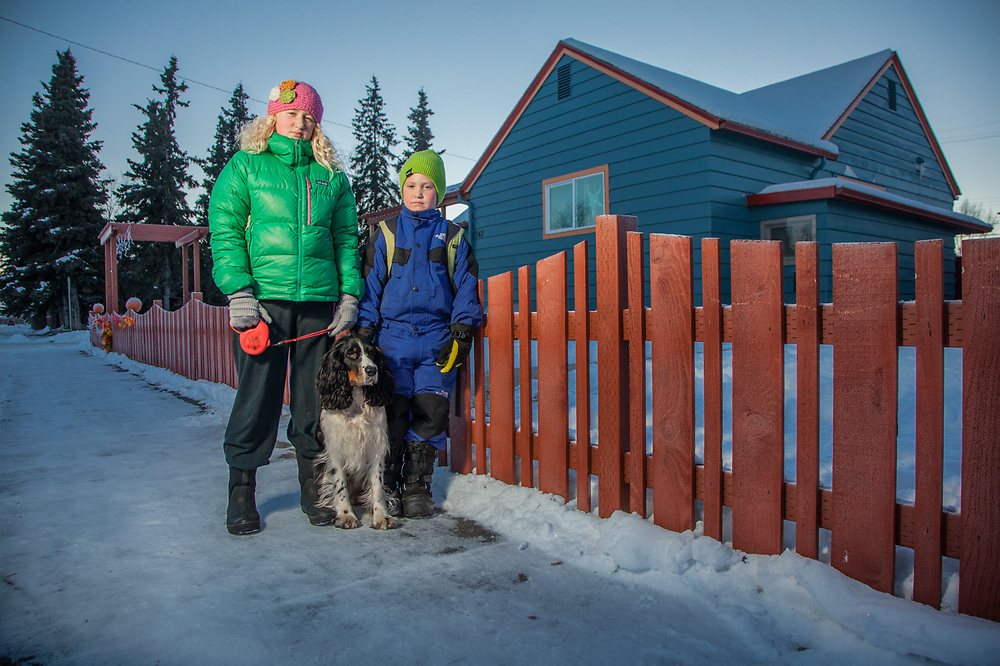 Mia (14) and Camper (8) Pillifant with their dog, Poppy, on H Street in Anchorage's South Addition neighborhood.  <Marya@benchmark-alaska.com>