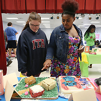 "Lauren Wood | Buy at photos.djournal.com<br /> Shannon High School freshman April Miles, left, and Jatavia Ford look at the different displays, including ""The Three Little Pigs"" as they vote for their favorite Friday morning during the Edible Book Festival at Shannon High School."