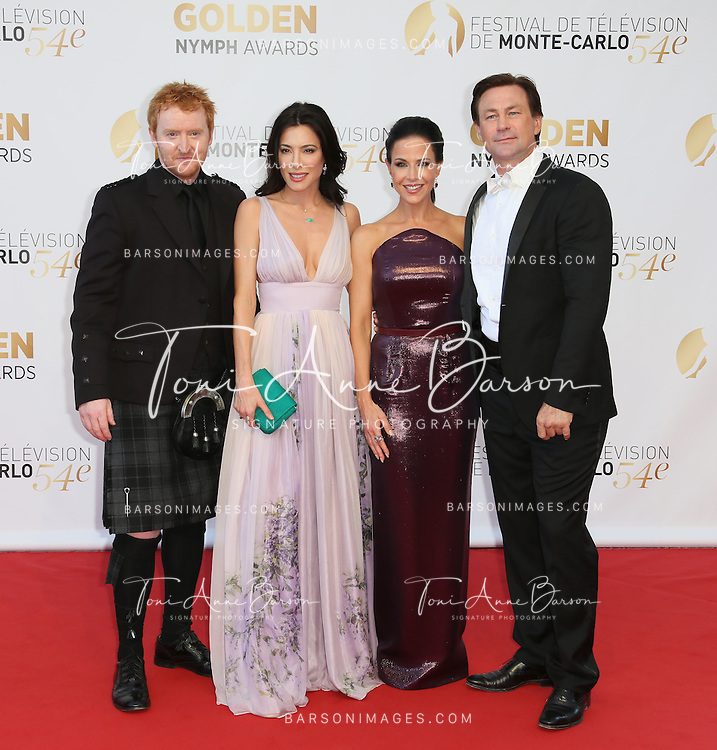 MONTE-CARLO, MONACO - JUNE 11: (L to R) Tony Curran, Jaime Murray, Julie Benz and Grant Bowler attend the Closing Ceremony and Golden Nymph Awards of the 54th Monte Carlo TV Festival on June 11, 2014 in Monte-Carlo, Monaco.  (Photo by Tony Barson/FilmMagic)