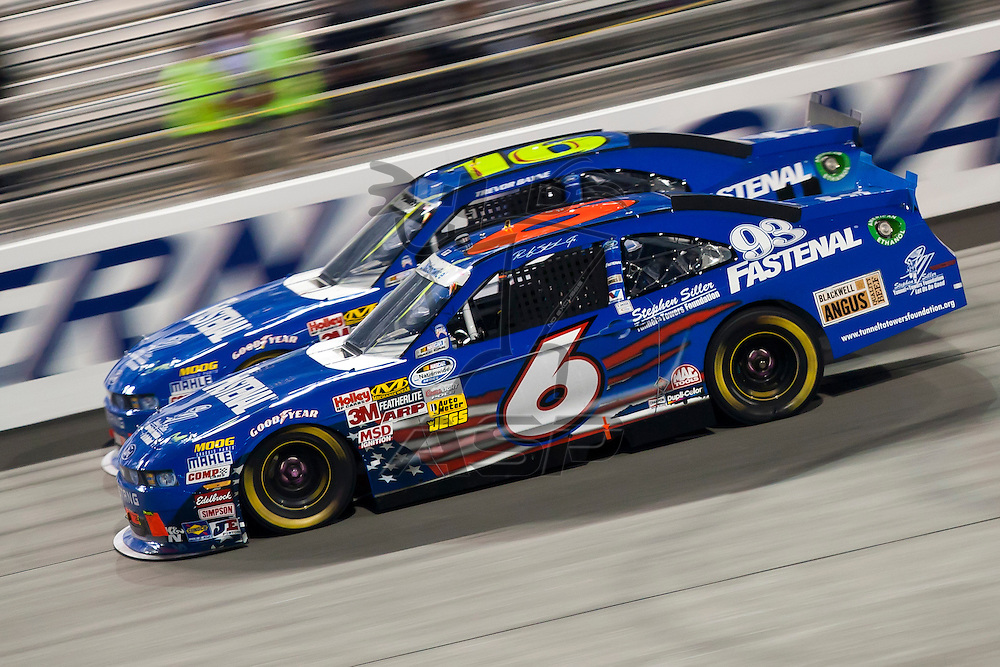 RICHMOND, VA  - SEP 09, 2011:  Ricky Stenhouse, Jr. passes Trevor Bayne during the Virginia 529 College Savings 250 at the Richmond International Raceway in Richmond, VA.