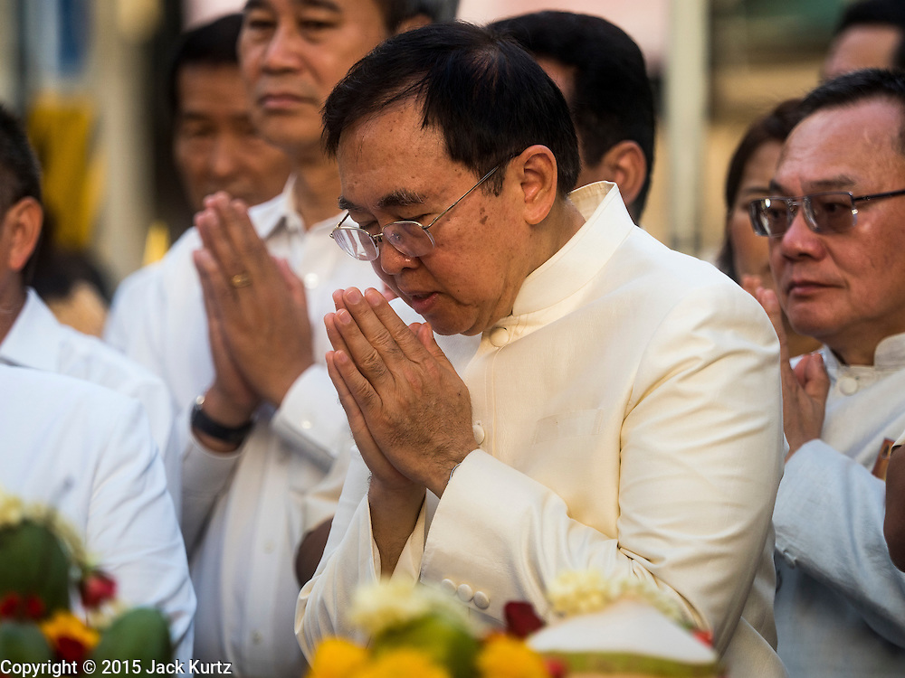 "04 SEPTEMBER 2015 - BANGKOK, THAILAND: VEERA ROJPOJANARAT, the Minister of Culture for Thailand, prays at the Erawan Shrine Friday. A ""Holy Religious Ceremony for Wellness and Prosperity of our Nation and Thai People"" was held Friday morning at Erawan Shrine. The ceremony was to regain confidence of the Thai people and foreign visitors, to preserve Thai religious customs and traditions and to promote peace and happiness inThailand. Repairs to Erawan Shrine were completed Thursday, Sept 3 after the shrine was bombed on August 17. Twenty people were killed in the bombing and more than 100 injured. The statue of the Four Faced Brahma in the shrine was damaged by shrapnel and a building at the shrine was damaged by debris.     PHOTO BY JACK KURTZ"