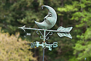 A weather vane with a man in the moon design points wind direction with an arrow, on Vendovi Island, Skagit County, Washington, USA. Vendovi Island was named after a Fijian High Chief Ro Veidovi who was brought to North America by the 1841 Wilkes Expedition. The San Juan Preservation Trust, a land trust for conservation in the San Juan Islands, purchased the island in December 2010 from the family of John Fluke Sr. Vendovi Island lies across Samish Bay from mainland Skagit County, between Guemes Island and Lummi Island, in the Salish Sea.