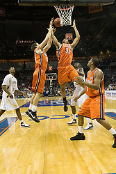 Virginia forward/center Ryan Pettinella (34) and Virginia forward Mike Scott (32) leap for a rebound against GT.  The Virginia Cavaliers faced the Georgia Tech Yellow Jackets in the first round of the 2008 ACC Men's Basketball Tournament at the Charlotte Bobcats Arena in Charlotte, NC on March 13, 2008.
