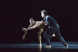 © Licensed to London News Pictures. 05/10/2015. London, UK. L-R: Andrea Carrucciu and Leon Poulton. BalletBoyz return to Sadler's Wells with their programme Young Men, a portrayal of love, loss and survival set against the backdrop of war. Produced by BalletBoyz artistic directors Michael Nunn and William Trevitt, Young Men is choregraphed by Ivan Perez and features an original score by Keaton Henson. Photo credit: Bettina Strenske/LNP