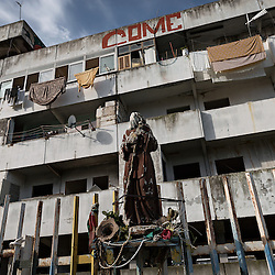 "Italy, Scampia (Naples). On November 10 it started emptying of the ""Vele"", buildings became famous worldwide as one of the most important centers of crime and drug dealing. Families, after almost forty years in the ""Vele"", received new apartments in which to move, the old structures, however, will be demolished to facilitate the resumption of the neighborhood and eliminate the huge degradation. The housing complex of ""Vele"" of Scampia, designed by Franz Di Salvo, was illegally occupied by many families left homeless after the 1980 Irpinia earthquake. The celebrity of ""Vele"" is also due to the film ""Gomorrah"" directed by Matteo Garrone and the homonym TV series. Italy, Scampia (Naples). On November 10 it started emptying of the ""Vele"", buildings became famous worldwide as one of the most important centers of crime and drug dealing. Families, after almost forty years in the ""Vele"", received new apartments in which to move, the old structures, however, will be demolished to facilitate the resumption of the neighborhood and eliminate the huge degradation. The housing complex of ""Vele"" of Scampia, designed by Franz Di Salvo, was illegally occupied by many families left homeless after the 1980 Irpinia earthquake. The celebrity of ""Vele"" is also due to the film ""Gomorrah"" directed by Matteo Garrone and the homonym TV series. Italy, Scampia (Naples). On November 10 it started emptying of the ""Vele"", buildings became famous worldwide as one of the most important centers of crime and drug dealing. Families, after almost forty years in the ""Vele"", received new apartments in which to move, the old structures, however, will be demolished to facilitate the resumption of the neighborhood and eliminate the huge degradation. The complex of ""Vele"", designed by Franz Di Salvo, was illegally occupied by many families left homeless after the 1980 Irpinia earthquake. The celebrity of ""Vele"" is also due to the film ""Gomorrah"" and TV series."