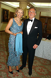 LORD & LADY HINDLIP at a private view of the forthcoming sale 'Property from the collection of HRH The Princess Margaret, Countess of Snowdon' and a private view of art by Marina Karella Princess Michael of Greece, held at Christie's, 8 King Street, London SW1 on 12th June 2006.<br />