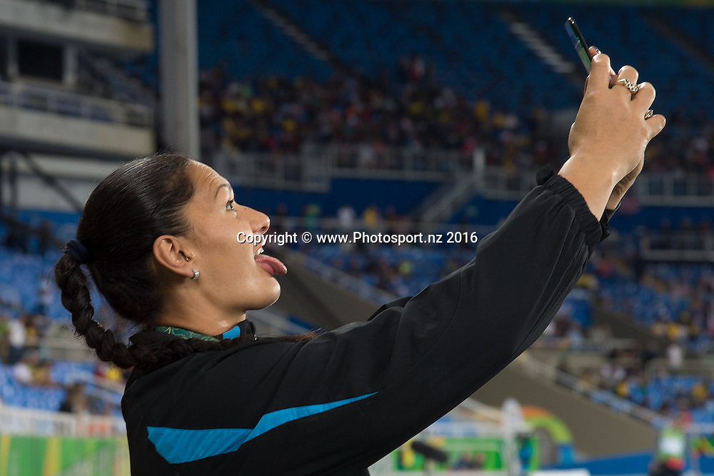 New Zealand's Valerie Adams takes a selfie during a medal ceremony for the Women's Shot Put in Olympic Stadium at the 2016 Rio Olympics on Saturday the 13th of August 2016. © Copyright Photo by Marty Melville / www.Photosport.nz