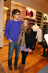 ISAAC FERRY and SCARLETT STRUTT at a party to celebrate the opening of the new Uniqlo store at 331 Oxford Street, London W1 on 6th November 2007.<br />