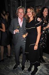 ALLAN PETERS and TRACEY EMIN at a dinner hosted by Ruinart in honour of Amanda Wakely at The Connaught, Carlos Place, London on 20th October 2010.