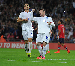 England's Wayne Rooney (Manchester United) celebrates his penalty. - Photo mandatory by-line: Alex James/JMP - Mobile: 07966 386802 - 3/09/14 - SPORT - FOOTBALL - London - Wembley Stadium - England v Norway - International Friendly