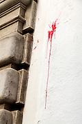 paint ball red dot splatter on a wall