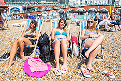 © Licensed to London News Pictures. 28/05/2018. Brighton, UK. (L to R) GISELLE, ANNA and MARTINA from Argentine take advantage of the hot and sunny weather to spend time on the beach in Brighton and Hove on the last day of the Bank Holiday Weekend. Today, Monday May 28th 2018 is predicted to be the hottest day of the year so far. Photo credit: Hugo Michiels/LNP