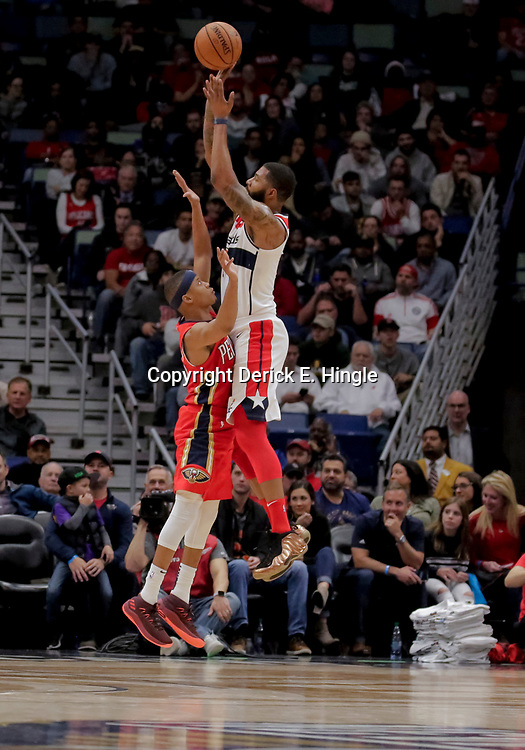 Nov 28, 2018; New Orleans, LA, USA; Washington Wizards forward Markieff Morris (5) shoots over New Orleans Pelicans guard Tim Frazier (10) during the fourth quarter at the Smoothie King Center. Mandatory Credit: Derick E. Hingle-USA TODAY Sports
